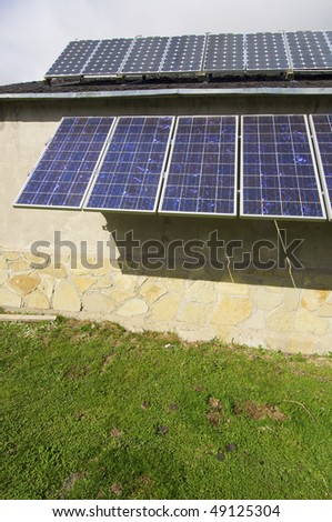 group of PV panels on the roof of a house in the Pyrenees - stock photo