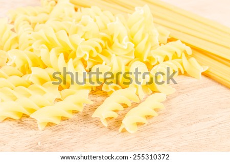 group of raw pasta on wooden background