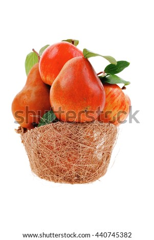 group of red and green fresh ripe apples and gold pear in basket isolated over white background - stock photo
