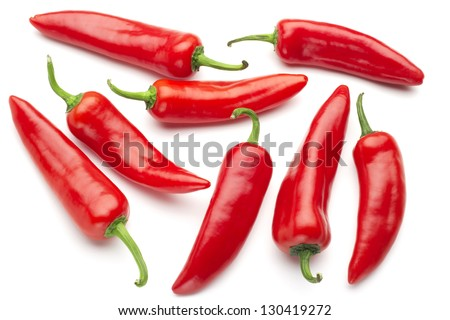 group of red chilies on white background - stock photo