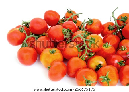 Group of red tomatoes on white background. - stock photo
