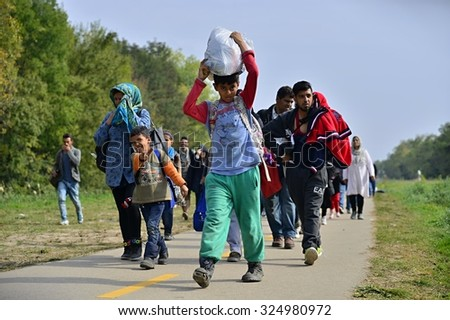 Group of refugees leaving Hungary. They came to Hegyeshalom by train and then they leaving Hungary and go to Austria and then to Germany. October 6,2015; Hegyeshalom in Hungary.