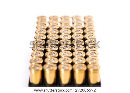 group of revolvers bullets on white background - stock photo