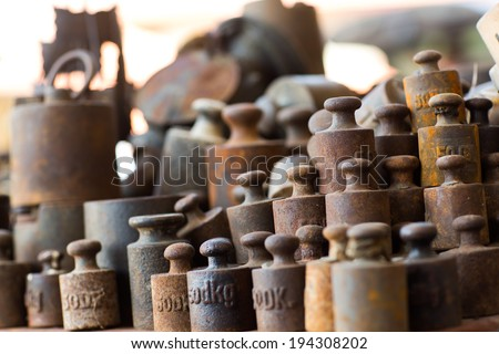 Group of rusty vintage weights - stock photo