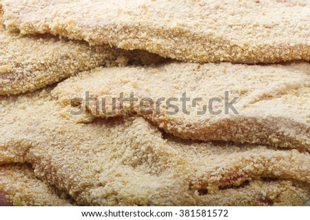 group of schnitzel ready to fry on plate  - stock photo