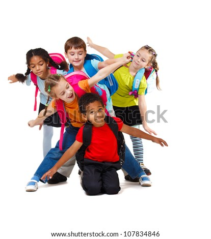 Group of school aged kids with backpacks - stock photo