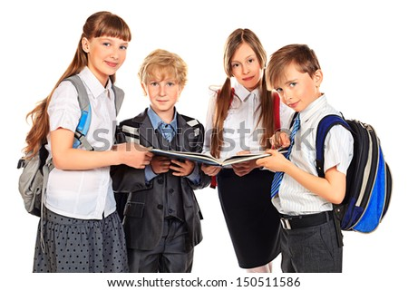 Group of school boys and girls standing together and reading a book. Education. Isolated over white background.