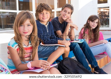 Group of school kids sitting on stairs