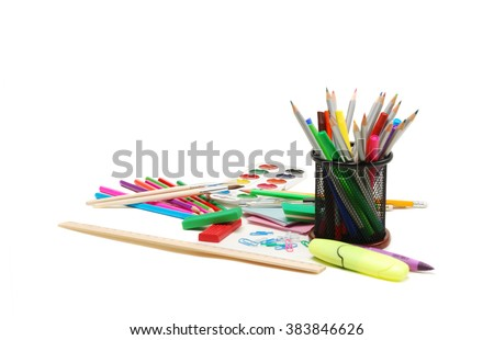 Group of school supplies, watercolor paints, color pencils and markers, isolated on white background