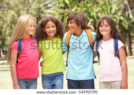 Group Of Schoolchildren Standing In Park - stock photo