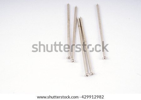 Group of screws isolated on white background. DOF and copy space.  - stock photo