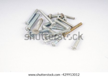 Group of screws isolated on white background. DOF and copy space.