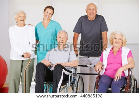Group of senior people together in nursing home during physiotherapy - stock photo