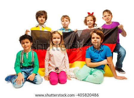 Group of seven children sitting with a German flag