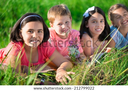 Group of several children resting in international camp - stock photo