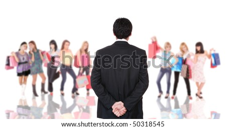 Group of shopping girls with man standing in front of them over white background