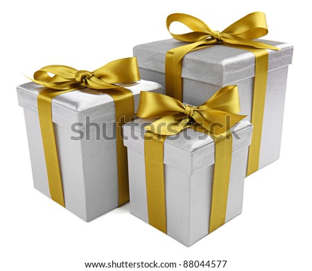 group of silver presents with a golden ribbon on white background - stock photo