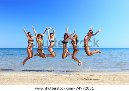 Group of Six Attractive girl jumping on the beach in Greece - stock photo