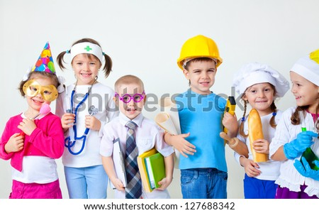 Group of six children dressing up as professions - stock photo