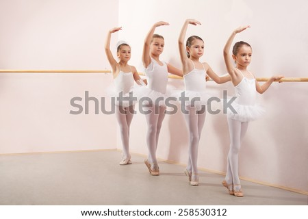 Group of six little ballerinas posing together with back to camera. They are good friend and amazing dance performers - stock photo