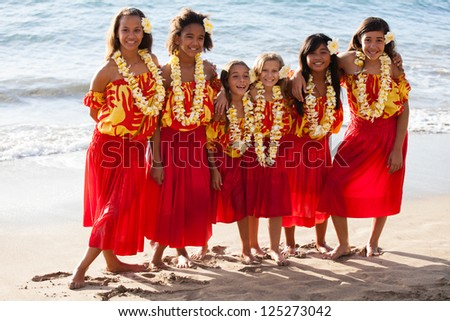 Group of six polynesian Hula girls  in Friendship looking at camera - stock photo