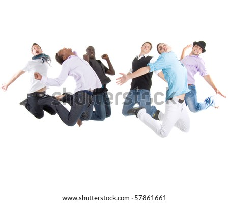 Group of six young stylish teenagers jumping in joy over white background. - stock photo
