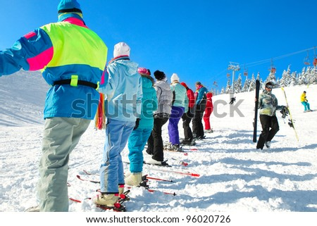 Group of skiers come upstairs snowy mountains (ski touring) - stock photo