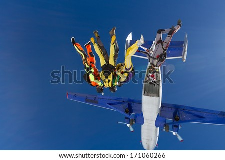 Group of skydivers in free style. - stock photo