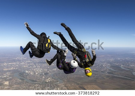 Group of skydivers in freefall. - stock photo