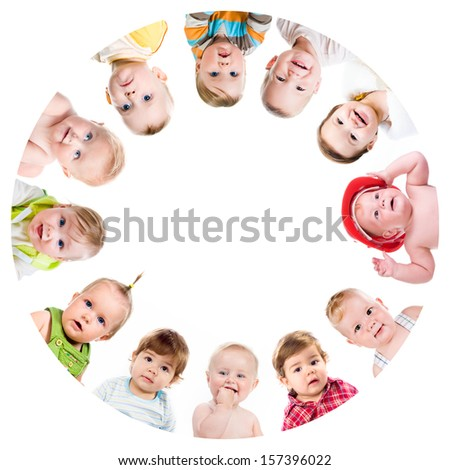 Group of smiling babies standing in huddle on white background - stock photo