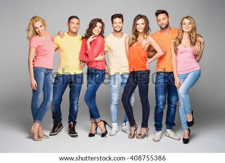 Group of smiling beautiful models in colorful clothes