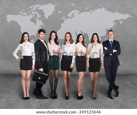 Group of smiling business people. Business team with map on background - stock photo