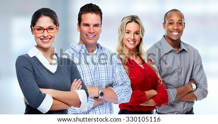 Group of smiling business people over blue background - stock photo