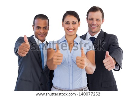 Group of smiling business people showing their thumbs up on white background - stock photo