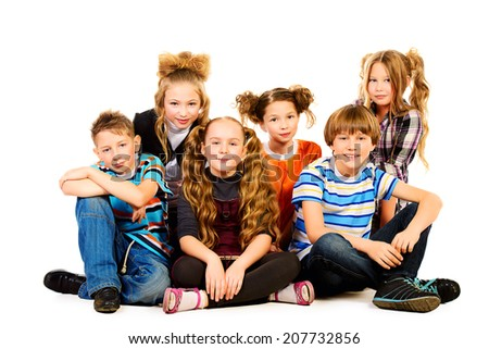 Group of smiling children sitting together. Isolated over white. - stock photo