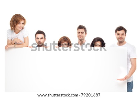 group of smiling friends advertising blanck banner - stock photo