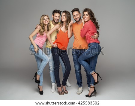 Group of smiling friends in fashionable clothes - stock photo