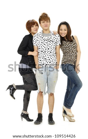 Group of smiling friends standing and looking at camera. - stock photo