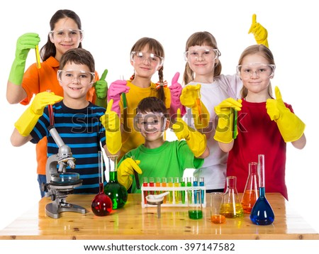 Group of smiling kids in protective glasses and gloves holding a chemical test tubes, isolated on white