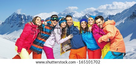 Group of smiling snowboarders friends
