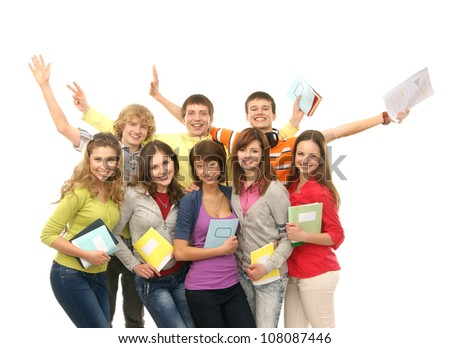 Group of smiling teenagers staying together and looking at camera isolated on white - stock photo