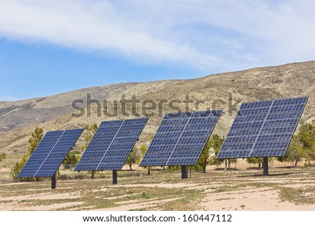 Group of solar panels used in a rural area.