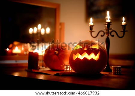 Group of spooky Halloween jack-o-lanterns lit at night