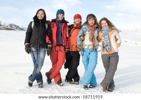 Group of sport teens different ethnicity winter outdoors at mountain Tien Shan. One boy and four girls