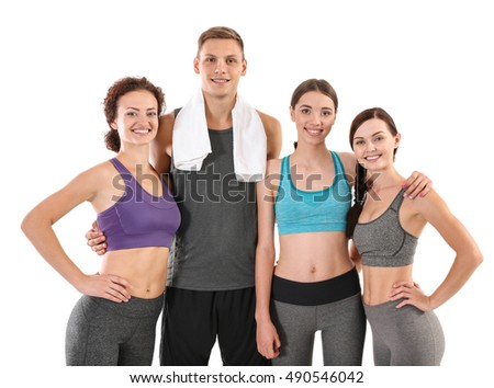Group of sportive people on white background