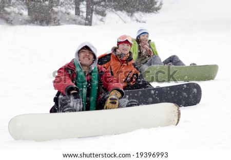 Group of sports teenagers snowborders in mountains in snow - stock photo