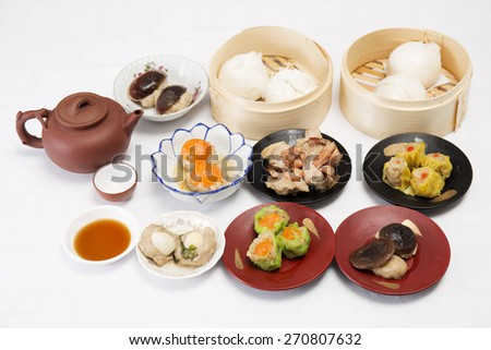Group of stream Dim Sum chinese food and hot Tea / Cooking Dim sum concept - stock photo