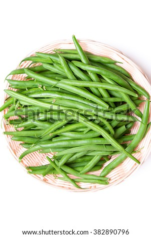 group of string beans also call green bean in a bamboo basket on isolated white background copy space - stock photo