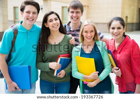Group of student with notebook outdoor - stock photo