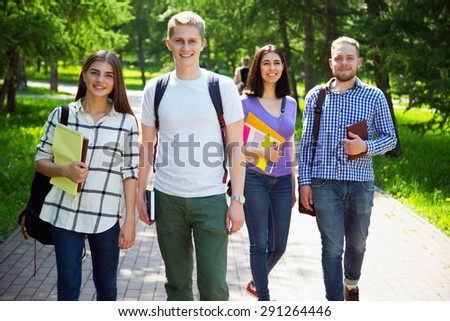 Group of student with notebooks outdoor - stock photo